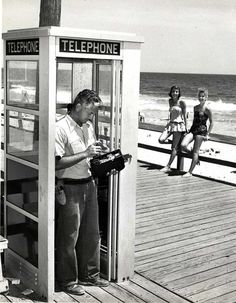 July 7, 1959.  Diamond State Telephone Co. repairman working on pay phone of the boardwalk of Bethany Beach in Delaware.  9015-003-001 #26.  From the Purnell Collection at the Delaware Public Archives.  www.archives.delaware.gov