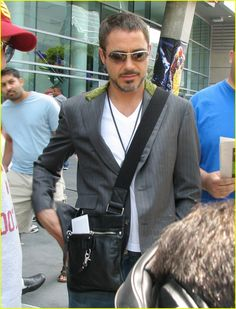 RDJ with his man purse :)