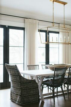 A transitional black and white dining room by Kate Marker Interiors gets recreated for less by copycatchic luxe living for less budget home decor and design Transitional Home Decor, Transitional Living Rooms, Transitional Kitchen, Transitional Lighting, Transitional Style, Plywood Furniture, Black French Doors, Black Doors, Black And White Dining Room