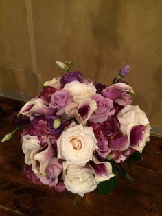 diamond jewels add sparkle to the calla lilies in this bouquet