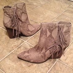 Snake Fringe Wedge boots Host Pick Snake Fringe Wedge Boots by Isola. NEW! Faux snake texture with suede fringe. Wedge is 4 inches. Isola Shoes Wedges