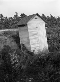 Outhouse Series: View showing an outhouse. Careful going in! It looks ready to tip! | Florida Memory