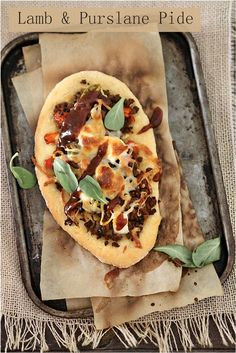 Turkish Flatbread pizza with lamb, seasonal greens, cottage cheese, and bell pepper