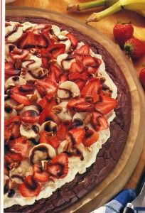1 package (21 oz) brownie mix (plus ingredients to make)  1 package (8 oz) cream cheese, softened  1 can (8 oz) crushed pineapple, drained  2 Tbsp. sugar  2 bananas, sliced  1 cup strawberries, sliced  1/2 cup chopped nuts  1/4 cup chocolate ice cream topping  cook brownie mix 375 - 15 min then mix cream cheese , sugar, pineapple and spread on top arrange banana and s-berries - drizzle chocolate