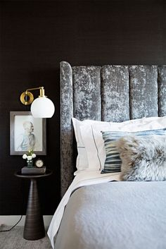 velvet tufted headboard in moody bedroom