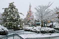 Disneyland Paris in the winter. Wow, This is so surreal seeing a Disney Castle in the snow.