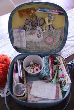 suitcase sewing box~~~I have a make up zip up bag/box that I have been looking to use for something. And now I know! Just sew a little fabric on top, maybe add a few little compartments and voila!!