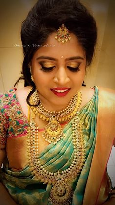 Niveditha glows for her reception. Makeup and hairstyle by Vejetha for Swank Studio. Coral lips. South Indian bride. Eye makeup. Bridal jewelry. Bridal hair. Silk sari. Bridal Saree Blouse Design. Indian Bridal Makeup. Indian Bride. Gold Jewellery. Statement Blouse. Tamil bride. Telugu bride. Kannada bride. Hindu bride. Malayalee bride. Find us at https://www.facebook.com/SwankStudioBangalore
