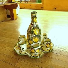 """11.5""""D; pitcher: roughly 10""""H  Bees  The perfect set for true Italian entertaining! This handmade and hand painted Italian pottery liqueur set includes a gorgeous limoncello pitcher, 6 limoncello cups, and a lovely tray which can be used on its own for serving appetizers!"""