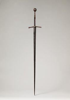 Hand-and-a-Half Sword Date: ca. 1400–1430 Culture: probably German Medium: Iron, copper alloy Dimensions: W. 3 lb. 7 oz. (1560 g); L. 49 1/8 in. (124.8 cm); L. of blade, 38 1/2 in. (97.8 cm); Wt. 3 lbs. 7oz. (1560 g)