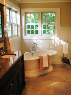 Really want to do the wainscotting...    from Amazing Tubs and Showers Seen On Bath Crashers : Home Improvement : DIY Network