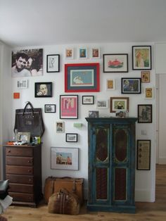 Wall decoration. There's no such thing as too many pics on a wall ;)