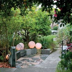 Place recycled plastic globes around a small patio, then put tea lights inside each one.