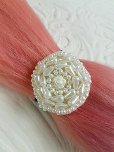 Check out this item in my Etsy shop https://www.etsy.com/nz/listing/501300792/pearly-white-rose-hair-tie-hair-elastic