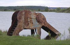 Derelict elephant water slide. Location unknown.