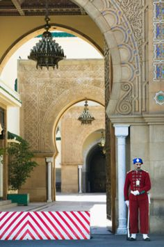 Morocco, Rabat, guard at Royal Palace entrance Soldier Costume, Colors Of Fire, Luxury Services, Public Garden, Royal Palace, Life Pictures, North Africa, Capital City, Amazing Destinations