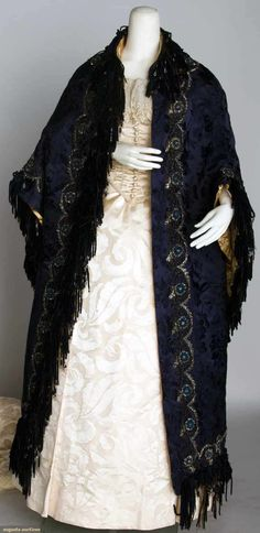 """SILK JACQUARD FULL LENGTH CAPE, 1888 -- Floral pattern in sapphire blue, cape & under-cape trimmed w/ cut steel beads & blue silk chenille fringe, French label, L 50.5"""""""