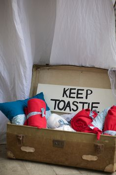 """Wintery wedding couples, here's a tip for you: have a blanket station for your wedding guests! Except you know I would put """"keep toastie"""" next to some toast. Might need to come up with some more puns!"""