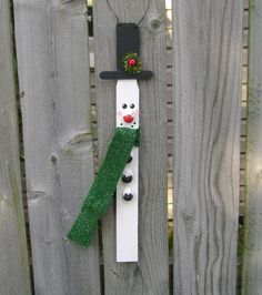 This paintstick snowman is all dressed up & nowhere to go