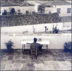Leonard Cohen playing quitar on the terrace of his house in Hydra (1960's)