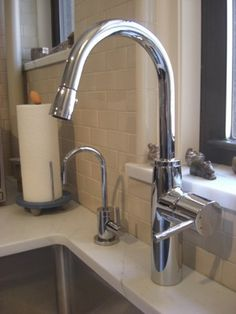 KWC Systema pull-down faucet and installed an EWS filtered water system and compatible small faucet from Newport Brass.
