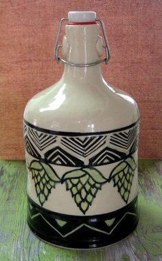 64 oz Ceramic Growler: wheelthrown hybrid porcelain/P-5, velour black underglaze sgraffito, celadon and leaf green under glazes, altanta clay clear dipped and fired to cone 6