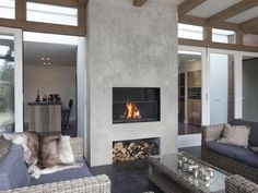 A beautiful outdoor fireplace prolongs those cool summer evenings. Our outdoor fireplace can be custom designed to all kinds of situations. Fireplace Wall, Fireplace Design, Fireplace Modern, Contemporary Outdoor Fireplaces, Interior Design Living Room, Home And Living, Living Spaces, New Homes, House Design