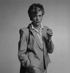 "David Bowie wearing the 1980's women's style ""power suit."" I think that's gender blurring times two."
