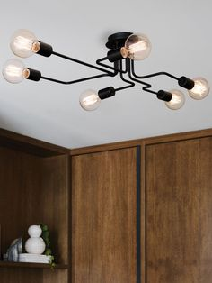 Pac 6 Light Pendant in Black - Love this unique, asymmetrical design.