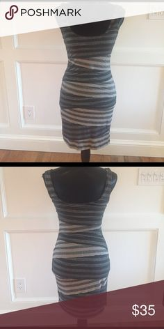 Grey and metallic material dress Fitted dress, worn a couple times Dressed Dresses
