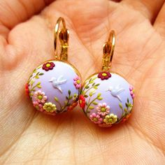 These earrings were a custom order. I love hummingbirds. Every detail, including hummingbirds, are made from polymer clay using only a tiny needle.  . . . . . . . . #fimo #polymerclay #clay #clayart #etsy #etsyshop #japanese #botanical #hummingbird #birds #flower #handmade #craft #pastel #pastelcolors #cute #kawaii #flowerjewelry #floraljewelry #embroidery #handembroidery #embroideryart #beadedjewelry #entomology #japan