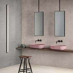 Italian surface manufacturer Fiandre creates beautiful porcelain stoneware slabs in pale, neutral colours. Here, in this minimalist bathroom, tone on tone cladding is defined with slimline mirrors and blackened metal hardware.
