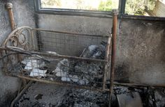 A handout picture released by the Higher Committee for the Syrian Revolution on April 11, 2012 shows a burnt out cot in a house destroyed by conflict in the town of Dael in the southern Syrian province of Daraa.