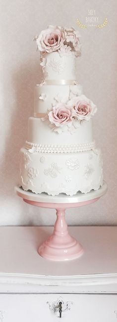 white wedding cake with sugar lace and roses / http://www.deerpearlflowers.com/16-perfect-romantic-vintage-wedding-cakes/