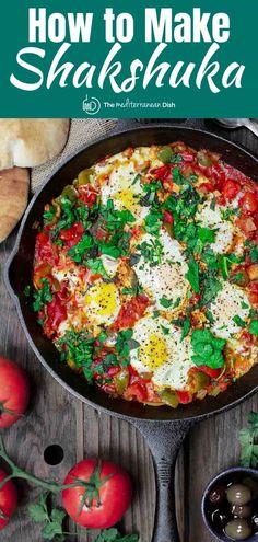 Hands down the best shakshauka recipe you'll try! Gently poached eggs in a simmering, flavor-packed chunky tomato sauce. Expert tips + Video included. #shakshuka #shakshukaeggs #eggs #breakfast #vegetarian