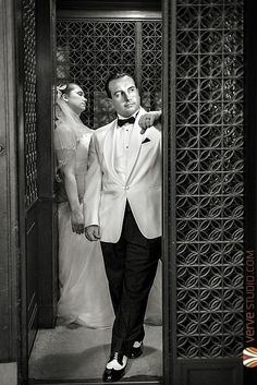 Taken in a 100-year old pulley elevator at the Hippodrome Theatre in Gainesville Florida.  Retro Vintage Hollywood Rat Pack Theme Inspired Wedding at Historic Hippodrome Theatre - gainesville florida wedding photographer Krystal Radlinski of Verve Studio