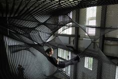 Net z33, looks to be made of the same netting material that trapeze artists use. It was installed at House for Contemporary Art Z33 in Hasselt, Belgium last year. Net was designed by the Coratian-Austrian design Collective Numen/For Use