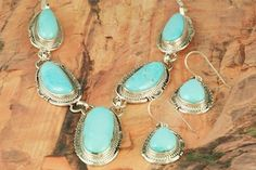 Native American Jewelry  Genuine Castle Dome Turquoise set in Sterling Silver. Necklace and Earrings Set. Created by Navajo Artist John Nelson. http://www.treasuresofthesouthwest.com/turquoise-jewelry.html