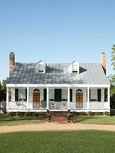 Definitely going with the porch across the whole front of the house and metal roof like Cody wants. Will go in town to add on or if/when we build with sheds, will just have to be colors - Red or Black......