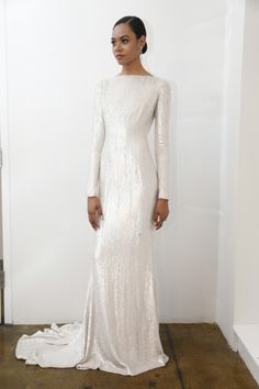 Long sleeve and sleek: http://www.stylemepretty.com/2015/04/17/pamella-roland-spring-2016-bridal-collection/
