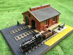 My twist on a victorian engine shed with a few of my trains used around 6000 bricks.