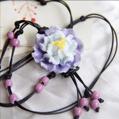 Hand made light purple ceramic flower necklace. Elegant  ceramic  hand made flower. The flower is around 4 cm. the strap is adjustable. Only one left Accessories
