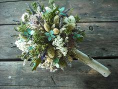 Earthy flower arrangement. This would look beautiful as a centrepiece.