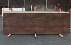 damn i like this.  iron-copper-neolith-slab-matte-10mm-brown-spain