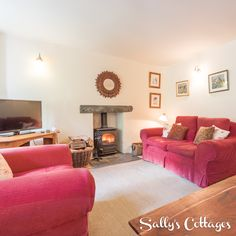 The deep red fireside sofas are perfect to sink into after a day out on the fells! This is the delightful living room at Beck View in Applethwaite!