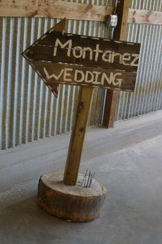Wooden direction sign for a wedding out in the Pecan Orchard. www.mdresort.com
