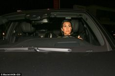 Calm: Kourtney appeared to keep her cool behind the wheel despite a sea of paparazzi
