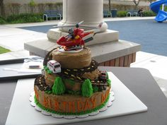 """rescue  trucks and helicopter - I made this """"rescue vehicle"""" cake for my grandson's 4th birthday."""