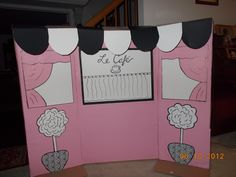 Photo Background for a pink, black and white French Poodle Birthday Party that I made with very little money = $3.00. I used   a big cardboard box and dollar store papers (pink wrapping paper and black and white poster boards). Kids will wear berets and mustaches on a stick when taking pictures. Should be fun!