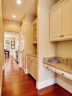 Spacious Kitchen w/ Cream Cabinets  wood with cream cabinets with this color walls looks nice and clean
